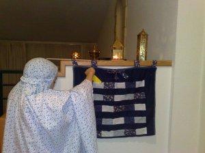 Girl choosing a card second day of Ramadan