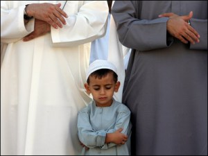 boy praying with elders