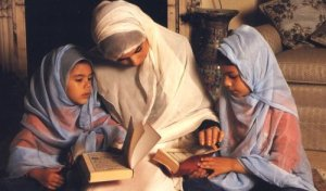 Muslim mother teaching her children