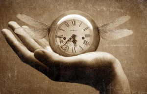 Hand holding a clock with wings